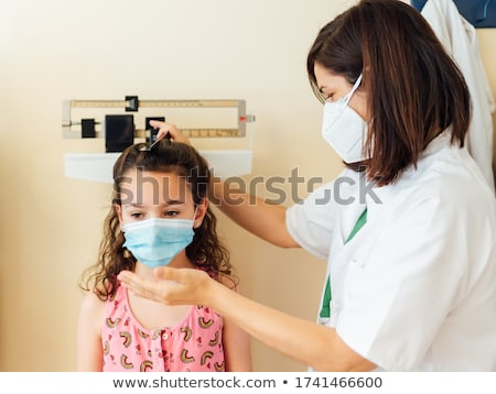 Doctor seeing patient in hospital Stock photo © Kzenon
