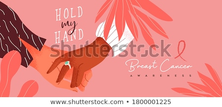 Survivors text and pink breast cancer awareness women holding card Stock photo © wavebreak_media