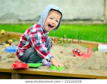 Boy playing in sandbox Stock photo © lichtmeister