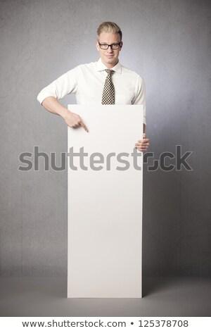 Neşeli adam işaret parmak beyaz panel Stok fotoğraf © lichtmeister