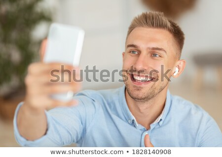 Millennial Man Recording Vlog With Mobile Phone For Social Media Stock photo © diego_cervo