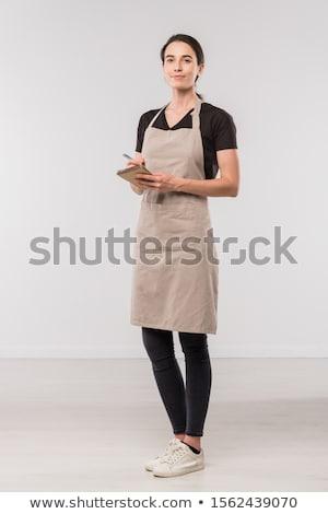 Joli jeunes serveuse café note Photo stock © pressmaster