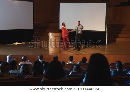High view of mixed race business colleague standing and discussing with each other in front of the a Stock photo © wavebreak_media