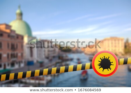 Warning sign with Coronavirus molecule on a police line on the blurred background of Grand Canal in  Stock photo © artjazz