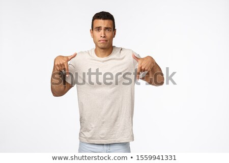 Rozczarowany ponury młodych opalony człowiek tshirt Zdjęcia stock © benzoix