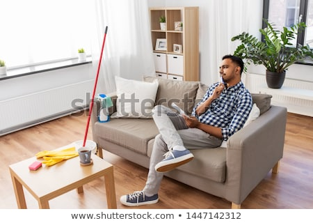 indian man making to do list after home cleaning Stock photo © dolgachov