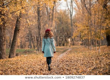 happy girl with fallen maple leaf at autumn park Stock photo © dolgachov