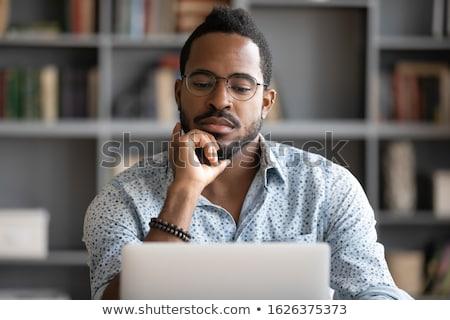 Jonge ernstig werknemer man papier hoed Stockfoto © elly_l
