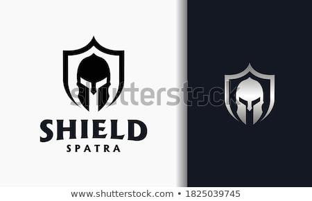 Foto d'archivio: Spartan Trojan Vector Mascot With Spear And Shield
