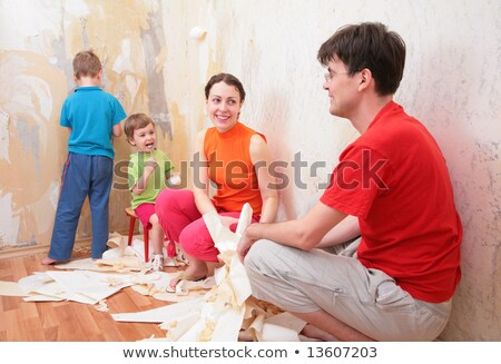 family makes interruption in  removal of  old of  wallpapers Stock photo © Paha_L