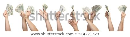 mans hand holds dollars stock photo © cookelma