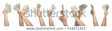 Foto stock: Mans Hand Holds Dollars
