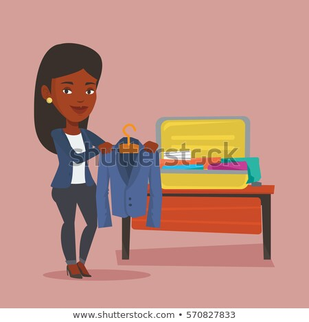 business travel young happy black woman with case stock photo © darrinhenry