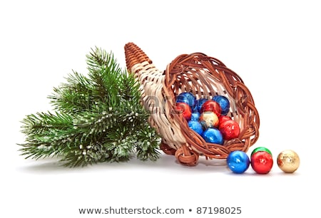 cornucopia of chocolate balls and pine branch stock photo © g215