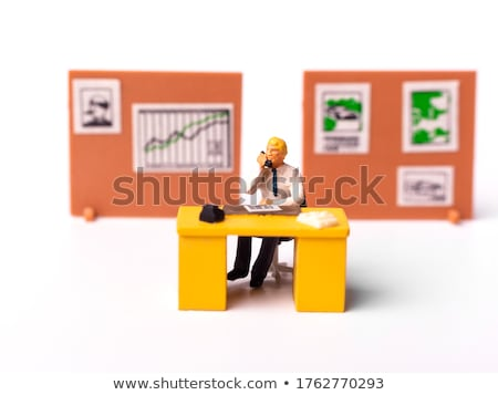 Puppet standing on chair and targeting chart Stock photo © vetdoctor