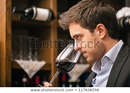 Stock photo: man tasting wine in cellar