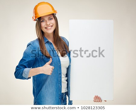 builder holding up a blank sign stock photo © photography33