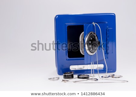 Woman opening a combination lock Stock photo © photography33