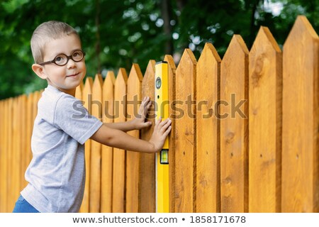 Construction of the frame plays a little boy happy. stock photo © justinb