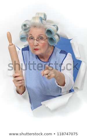 grandma with hair curlers threatening someone with rolling pin Stock photo © photography33