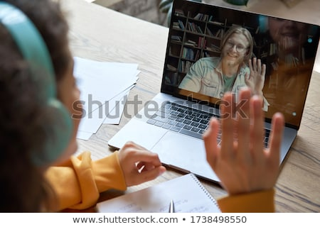 Teenager handing work in to male teacher Stock photo © photography33