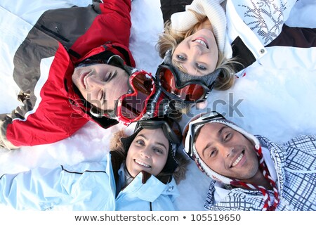Four friends laying in the snow Stock photo © photography33