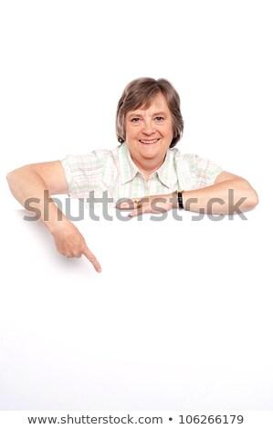 Gyönyörű öreg hölgy mutat tábla ujj női Stock fotó © stockyimages
