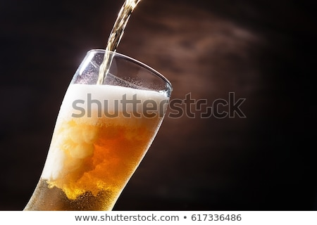 cold glass of beer with foam  stock photo © artush