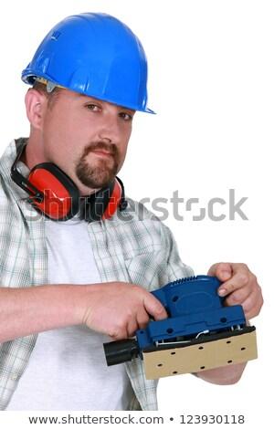 Mason demonstrating power sander Stock photo © photography33