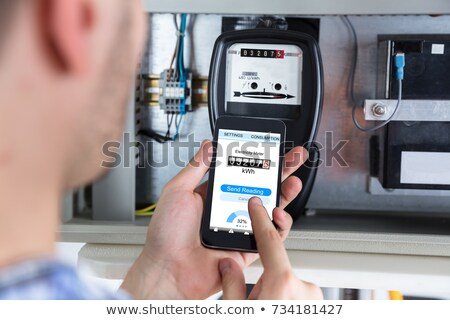 Electrician looking at voltmeter display Stock photo © photography33