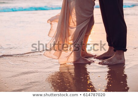 Couple in love hug in suset on sea Stock photo © lunamarina