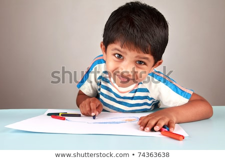 little boy drawing at school with wax crayons Stock photo © photography33
