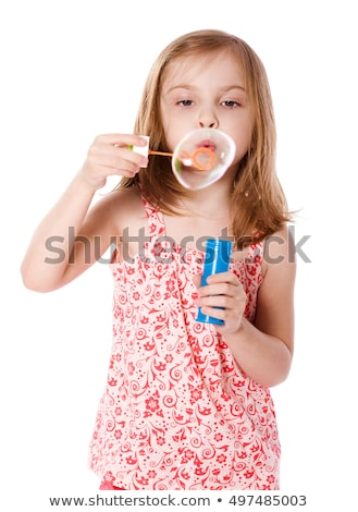 Smiling girl blow bubbles. Isolated Stock photo © acidgrey