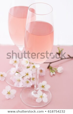 Two glasses filled with pink Champagne  Stock photo © Sandralise