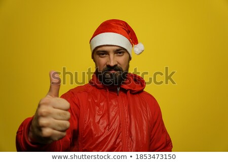 smiling young mad thumbs up Stock photo © godfer
