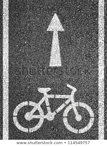 Bicycle road sign on asphalt Stock photo © monticelllo