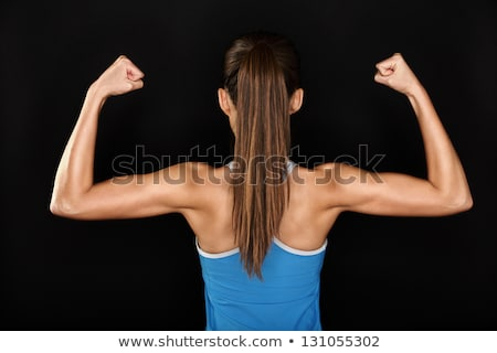 Foto d'archivio: Strong Fitness Woman Showing Back Biceps Muscles