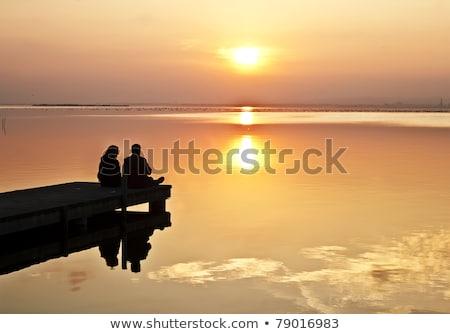 медовый месяц озеро отражение вечер солнце соснового Сток-фото © Gordo25