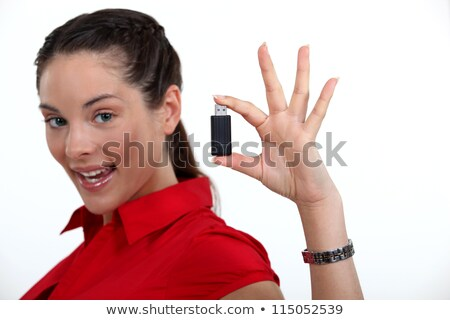 attractive woman showing usb key stock photo © photography33