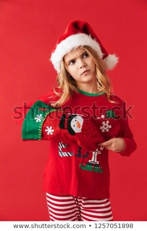 sad little girl with christmas stocking stock photo © bigjohn36