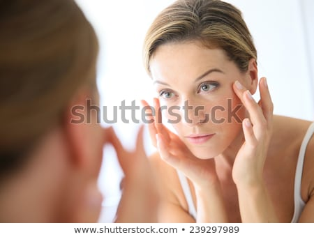 beautiful face with mirror Stock photo © ssuaphoto
