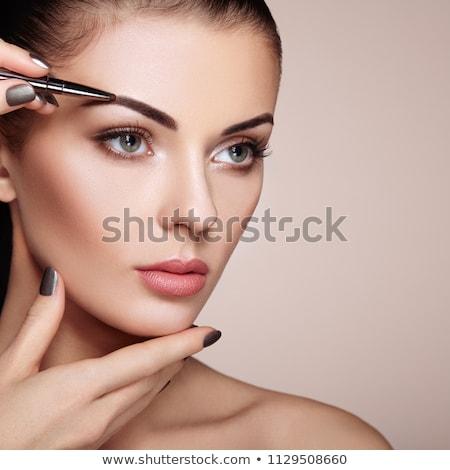 Foto d'archivio: Shining Woman Face Makeup