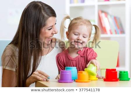 Happy mother and child in nursery stock photo © Kor