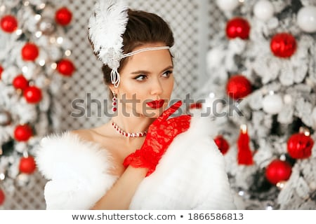 Beautiful brunette girl over feathers. stock photo © NeonShot