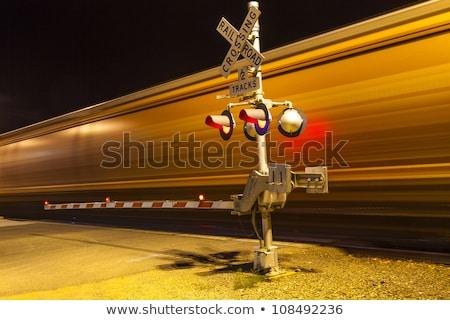 ferrovia · noite · assinar · carro · estrada · luz - foto stock © meinzahn