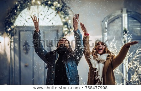 Beautiful girl in the city at Christmas time Stock photo © Nejron