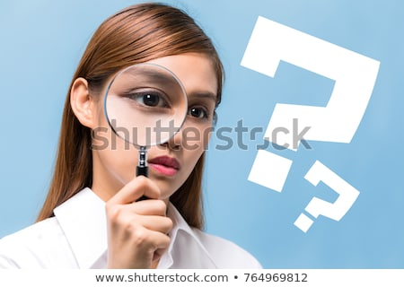 Businesswoman - Latina searching with magnifying glass Stock photo © dgilder
