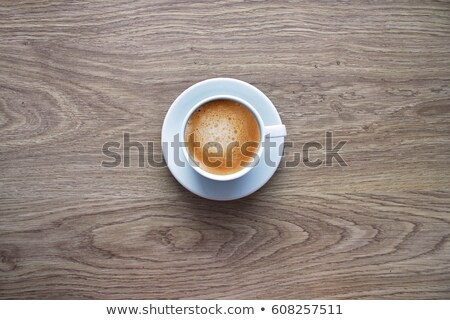 Drinking out of hot cappuccino on table, view from above Stock photo © nalinratphi