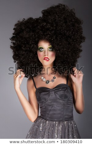 Updo. Eccentric Woman with Styled Curly Hairs Stock photo © gromovataya