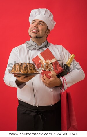 portrait of caucasian man with chef uniform sharing fresh cake stock photo © hasloo